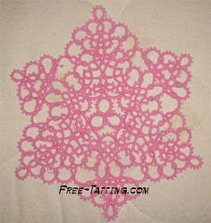 Tatted doily. Sort of an oversized snowflake. I may do this in a sparkly white thread with some beading.