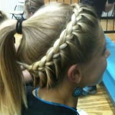 braided ponytail.. I have done this several times to Delaney's hair. It really isn't that hard and it looks cute!