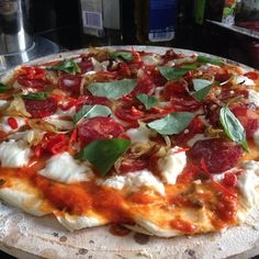 Homemade Pizza sitting on its pizza stone, ready for the oven #Food #Pizza #Italy #Recipe