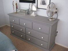 Beautiful grey dresser with 7 drawer and there are fan