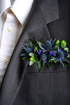 "An interesting take on a boutonniere, designed by Love 'n Fresh Flowers...instead of a pin-on version, this is a ""pocket square"". Just an idea since you were looking for unexpected touches. You would have to wear a jacket though."