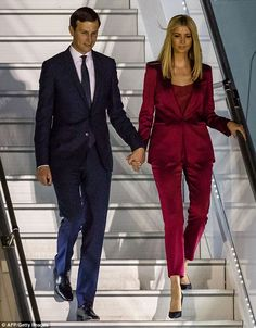 There she goes! Ivanka Trump was the epitome of chic in her red Escada suit as she landed in Poland, burgundy pantsuit, heels, July 5 or 6 2017