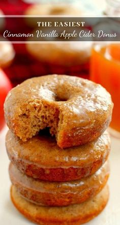 These Cinnamon Vanilla Glazed Apple Cider Donuts are baked to perfection with hints of fall spices and sweet apple cider. Covered in a vanilla glaze that's sweetened with cinnamon, these donuts are easy to make and the perfect treat for fall! #donuts #donutrecipe #applecider #appleciderdonuts #appledonuts #appledonutrecipe #appleciderdonutrecipe #applerecipe #fallrecipe #falldessert #falldonuts #dessert #fallbreakfast