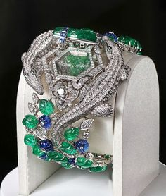Cartier diamond and emerald bangle bracelet
