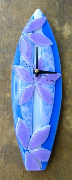 """Surf Board measures about 14"""" long by 4.5"""" wide.  Fused glass wall clock"""