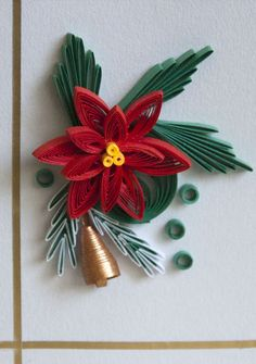 this poinsettia (quilling) is wonderful. I love the little gold bell.