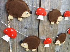 A super cute Hedgehog and mushroom garland made from felt.    Each piece is hand cut and sewn. The thick acrylic felt makes this garland robust and