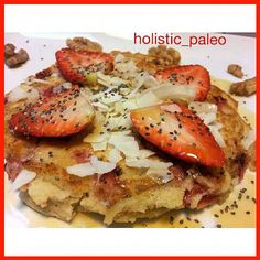 A very light and delicious paleo, gluten, dairy and sugar free pancake.  Filled with fresh strawberries,  coconut flakes & flaked almonds,  and topped with delicious nuts, seeds, fruit,  coconut flakes & maple syrup.  #pancake #paleo #holisticnutrition #f