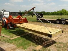 images of pond docks | ... loader boom pole to move it out to the pond where the dock awaited