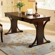 Caddoa Desk - Bring stately style to your home office or den with this handsome wood desk, showcasing a pedestal base and dark cherry finish.