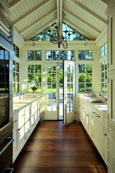 Kitchen with stunning backyard view.