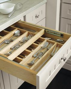 Don't pass on seemingly small add-ons and storage features, like additional drawer dividers, or cabinet storage solutions like pantry pullouts and lazy Susans. These storage solutions will increase your kitchen storage efficiency, and are much more costly to add on if you decide you need them down the road. Check out the Martha Stewart Living smart organization features in the latest kitchen catalog.