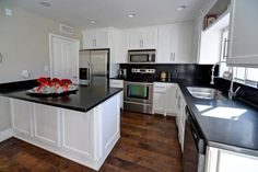 Traditional Kitchen with Hardwood floors, Slate counters, 30'' Freestanding Electric Range - Stainless, High ceiling, Slate