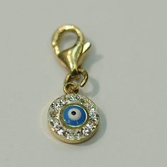 14kt Yellow Gold Evil Eye Charm with Lock.