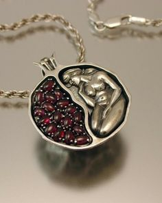 Pomegranate pendant (garnet and sterling silver).  Pomegranates are an ancient symbol of fertility and the Goddess.