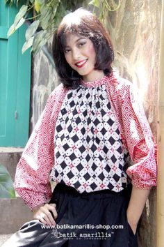 Batik Amarillis's Romancia Blouse  This Truly Romantic Bohemian style blouse is true to its name as it's reversible you can wear it from the front or back part either way is charmingly rad! It's freesize, gauzy, comfy  with blooming raglan sleeve and fit to your free spirited style!