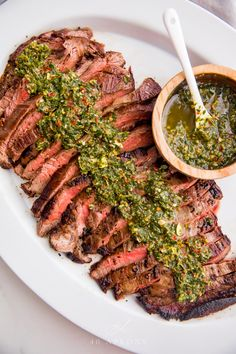 This chimichurri flank steak is crazy flavorful, thanks to a perfect chimichurri sauce. Cooked medium rare inside on the skillet, the flank steak is super tender, and it's all easy and quick to throw together for dinner, coming together in about 30 minute Paleo Recipes, Dinner Recipes, Cooking Recipes, Grilling Recipes, Seafood Recipes, Appetizer Recipes, Easy Recipes, Flank Steak Recipes, Skirt Steak