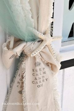 "If it said ""Keep calm and Sail on"" this would be SO cute for a beach home :)Tie a big bow with a piece of muslim to hold back ""foamy"", beachy looking curtains"