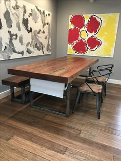 Dining room table with butcher paper roll.