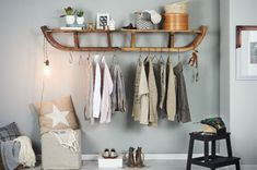 creative DIY coat rack made out of wooden sleds