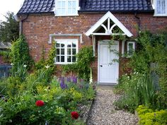 What a quaint old brick home with lovely garden.