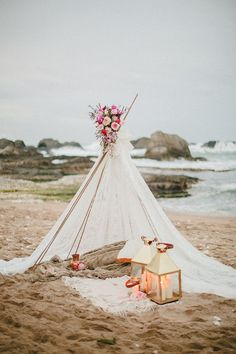 Having a beach bohemian teepee for the big day as a wedding or party idea. Complete with candles, string lights or flowers of your choice.