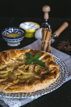 apple pie with fresh fruits on wooden table by huertas19