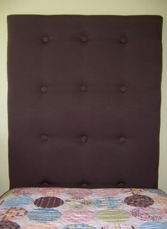I am going to make a tufted head board, with help from Keith, but not this boring rectangle