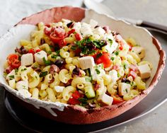 Italian Chicken Pasta Salad : Geoffrey Zakarian uses rotisserie chicken from the grocery store plus a bunch of items you likely have on hand to make this quick pasta salad. via Food Network