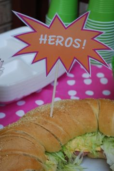 "Sticking to an all super hero inspired food table, guests enjoyed ""Hero Sandwiches,""  ""Wonder Dogs,""  ""Kryptonite"" jello shooters, ""Laser Vi..."