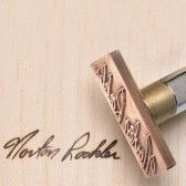 Rockler woodworking offers customized wood burning branding irons (Pyrography) online for Item $219.99 item #: 21204  Irons are either electric or torch heated irons and char the wood leaving behind a dark permanent imprint from the metal stamp body.  Online form accepts uploading (max 5000px square) files in jpg, jpeg, bmp, tiff, tif, gif format. Very high resolution for black and white graphic images.