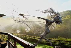 UK-based artist Robin Wight uses stainless steel wire to form stunning, dynamic sculptures of winged fairies dancing in the wind