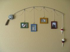 Fishing pole picture frames... cute idea for my paretns house