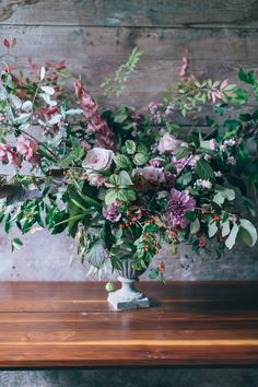 Love the subtle mauve, purple elements among all the shades of green; by Ariella Chezar Flower Workshop, Corbin Gurkin