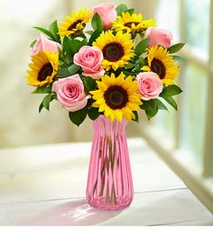 Our Ray of Sunshine Bouquet delivers smiles with golden sunflowers, light pink roses, gathered with fresh greenery. This summer bouquet is a cheerful gift to leave the people you love smiling. Sunflower Party, Sunflower Baby Showers, Sunflower Bouquets, Sunflower Room, Sunflower Vase, Red And Pink Roses, Beautiful Pink Roses, Light Pink Rose, Rosen Arrangements