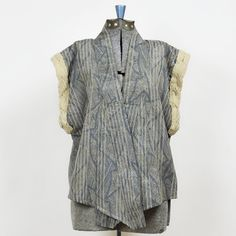 NUBE SEATTLE Kimono Flutter Vest  Crisp and smooth in muted blue, kimono styled vest with vintage lace trim detail. Drapes gracefully in a crossover at front without closures for an easy and elegant wear...at NuBe Green