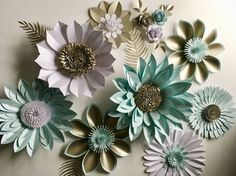 Giant paper flower backdrop, 3d wall decoration or photography prop, created in my studio to order and inspired by the surrounding flora of the English countryside.  Strikingly beautiful giant pearlescent card flowers that can be used in many different settings such as for an amazing backdrop to your wedding photos, wedding venue decoration or a photo booth backdrop. The quality of these flowers mean that after your wedding day they can be reused in your home or for another event such as a…