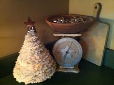 I made the Martha Stewart Shimmering Stacked Tree. i used old music sheets for my tree. My base is an old door knob. Love how it turned out.