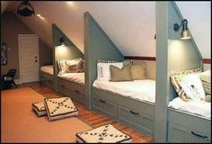 Attic room turned into kids bedroom. LOVE the beds
