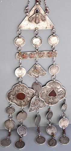 Ornament of silver with inlaid carnelian see through two sided window style, coral and coins. 19th c Khirghiz   (collection Linda Pastorino)