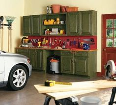 Repurpose old kitchen cabinets for additional garage storage on the cheap. Use peg board to hang tools for easy access.