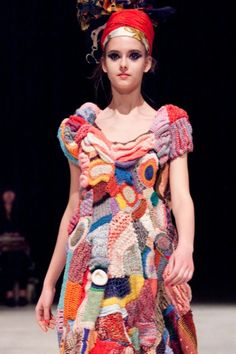 Takashi Aoki; The image is a garment by Aoki which uses knitting and crocheting to create a bright and bold statement piece. It uses similar shapes and colour to that of the selected concept and there is a interesting variation of depth and textures that are at play throughout the garment.
