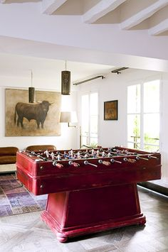 Home Tour: Rustic Modern Glamour in Paris // foosball table, game room, living room