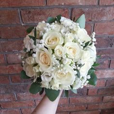 avalanche rose, lisianthus and gypsophila bouquet finished with a collar of eucalyptus.