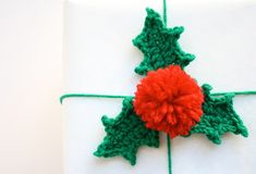 DIY Crochet Holly Gift Topper. Includes links to free crochet pattern and pom pom tutorial. | One Sheepish Girl