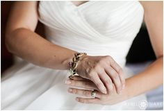 Bride puts on her grandmother's bracelet at the Sheraton Resort in Steamboat Springs, Colorado. - April O'Hare Photography http://www.apriloharephotography.com