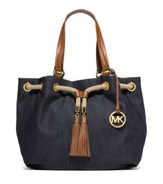 Divine in denim. Our Marina tote walks the line between carefree and classic. A rope drawstring and oversized tassels conjure a maritime moment, while our logo charm and leather details add panache. A cinchable silhouette expands to hold all your must-haves and looks inimitably chic over the shoulder.