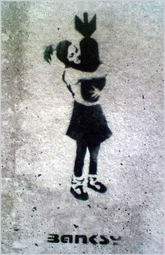 Banksy Girl Bomb Hugger London East End The picture of a young girl hugging a bomb to her chest was one of Banksy's original creations back in 2003, where it was reproduced on a wall in London's East End. The piece symbolises the horror of war next to the innocence and purity of the young girl – good and evil unified and questioned as to why we inherently indulge in war and fighting when peace can be all around us. Thought-provoking stuff.