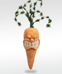 Wonder what upset this guy?  Angry Carrot by chickenlipsfolkart on Etsy, $48.00