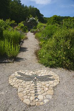"Gresgarth Hall Brilliant pebble mosaic paving designed by Maggy Howarth adorns Arabella Lennox-Boyd's magical garden in Lancashire."", ""pinner"": {""username"": ""first_name"": ""Alison"", ""domain_url"": null, ""is_default_image"": true, ""image_medium_url"":. Garden Crafts, Garden Projects, Garden Paths, Garden Landscaping, Landscaping Ideas, Walkway Ideas, Pebble Mosaic, Stone Mosaic, Rock Mosaic"
